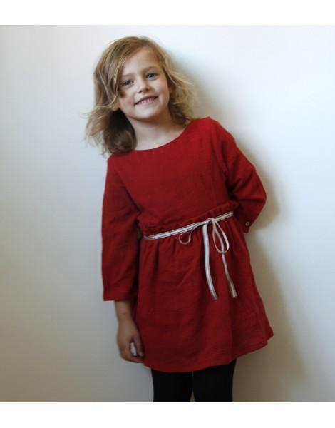Niña con Vestido Lazo Rojo